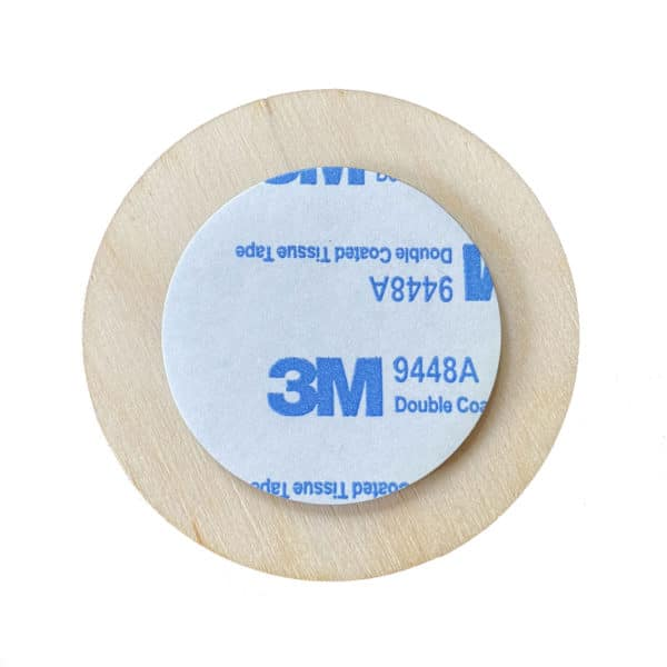 Reverse side of round wooden stickers with a 3M sticky pad
