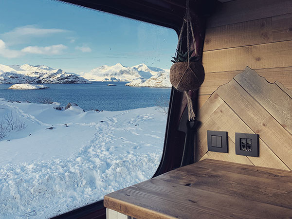 Snowy view over Lofoten in Norway out our our van window where campervan heating was essential!