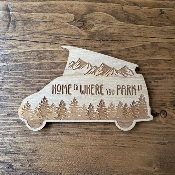 Pop top camper van sticker on wooden background