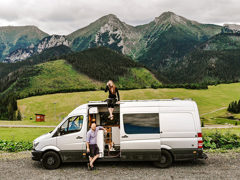 Us, our van and the Tatra Mountains at a free campervan parking spot in Slovakia