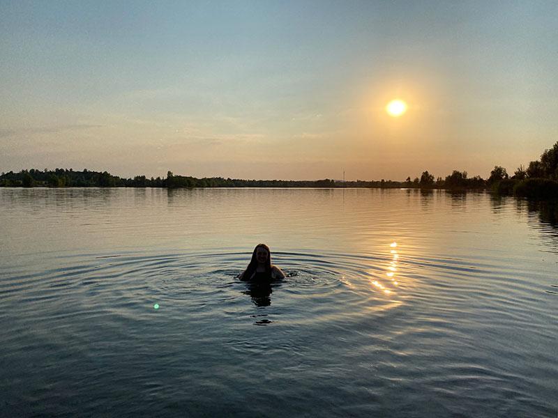 Swimming in Goringer See lake at sun set