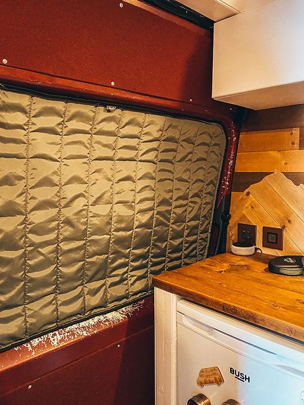 Inside of van side door showing a major ban build mistake with paint peeling off