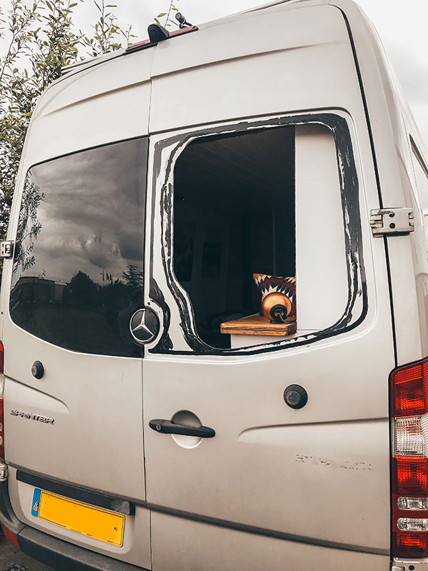 Van Build Mistakes - Our rear window is removed after nearly falling out!