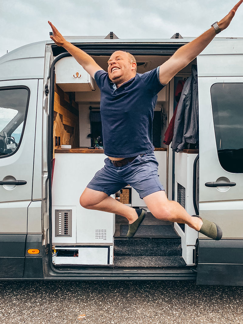 Jumping out of campervan in outdoor slippers
